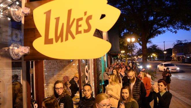 A line forms on Wednesday, Oct. 5, 2016 at Strange Matter Coffee Co. for Luke's Coffee Day, which is inspired by the show Gilmore Girls. The line spanned most of the block.