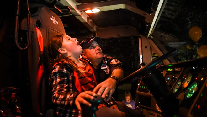 Will Gaiski, a firefighter with the Fort Indiantown Gap Fire Department, shows Annalis Olan, 6, of Palmyra the controls of Crash 75, as Palmyra Fire Department held its last open house at its North College Street fire station, built in 1923, on Thursday, Oct. 13, 2016. The event featured tours, fire apparatus, displays, demonstrations, activities and much more in conjunction with fire prevention month. The department is building a $4.6 million, two-story, 24,000-square-foot fire station in the first block of West Walnut Street just behind the borough office at 325 S. Railroad St.
