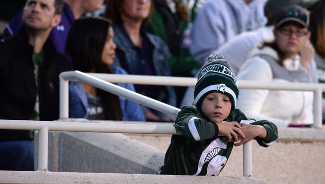 A young fan reacts during the game against Northwestern on Saturday, Oct. 15, 2016 at Spartan Stadium in East Lansing. Northwestern defeated MSU, 54-40.