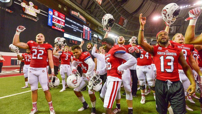 The USD football team celebrates its victory over Illinois State with the Coyote faithful at the DakotaDome on Saturday.
