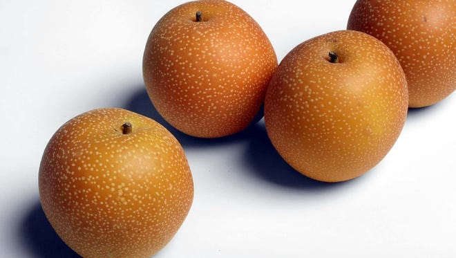 Underneath the thin, smooth, edible skin of the yellow, green or golden-brown Asian pear is juicy, sweet and mild-flavored flesh with a crisp texture.