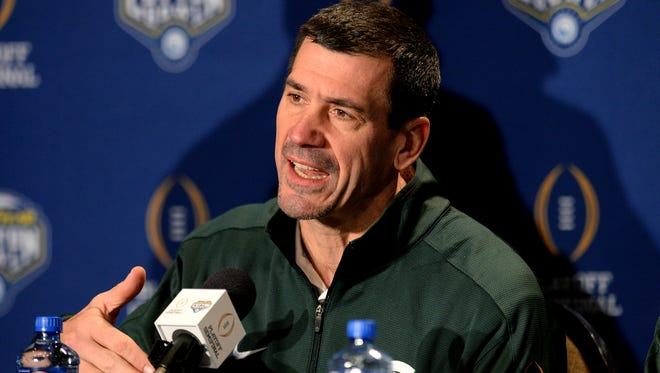 MSU co-offensive coordinator Dave Warner, here answering questions before last year's College Football Playoff semifinal, has come under fire from fans this season as MSU's offense has sputtered.