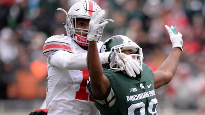 Ohio State cornerback Denzel Ward blocks a pass to senior wide receiver Monty Madaris during the game against Ohio State on Saturday, Nov. 19, 2016 at Spartan Stadium in East Lansing.