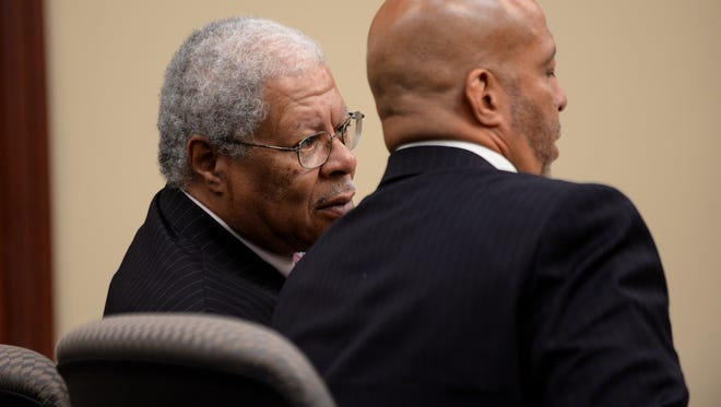 Former Ingham County Prosecuting Attorney Stuart Dunnings III talks to his attorney Vincent Toussaint during a hearing earlier this month. Dunnings will  be sentenced today for his felony and misdemeanor convictions.