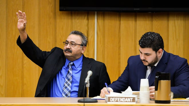 Hector Arroyo, the Lansing man charged in connection with the hit-and-run crash that killed a Waverly student, raises his right hand before testifying at his plea agreement hearing at the Eaton County Courthouse Friday, Dec. 2, 2016 in Charlotte. Arroyo could serve a year in jail when sentenced in January.