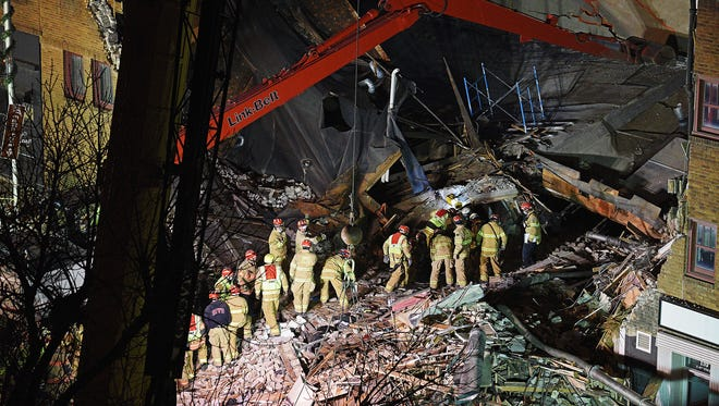 Emergency personnel work to recover the body of a construction worker who died in the Copper Lounge building collapse Friday, Dec. 2, 2016, in downtown Sioux Falls.