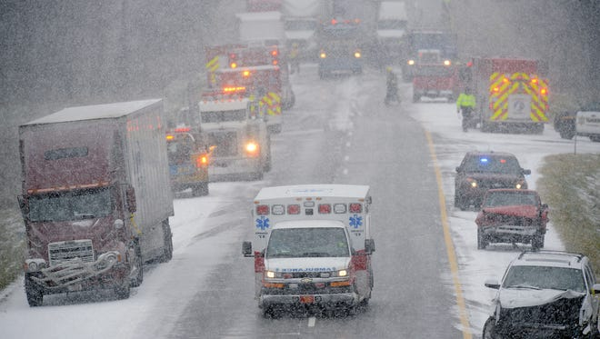 Emergency crews on the scene of a multiple-car pileup on I-96 between Webberville and Fowlerville Thursday, Dec. 8, 2016.