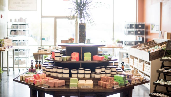 """The handmade products at Buff City Soap – formerly The Bartlett Soap Company – range from body, skin and face care to pet products and even laundry detergent. There are more than 30 varieties of soap alone, including toasted coconut, birthday cake, rosemary mint and the humorous """"Zombie Repellent,"""" a neon-green soap with a tropical scent."""