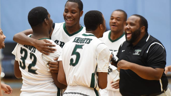 Mount Pleasant's Isaiah McCready (32) is congratulated after scoring the final basket in the Green Knights' 69-43 win over St. Michael's of Toronto at Slam Dunk to the Beach on Dec. 29