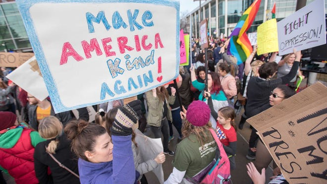 Several thousand people take part in a women's march on the campus of Wayne State University.