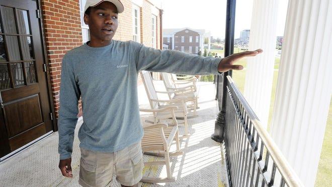 University of Alabama student body president Jared Hunter talking on the balcony of his Theta Chi fraternity house in Tuscaloosa, Ala.