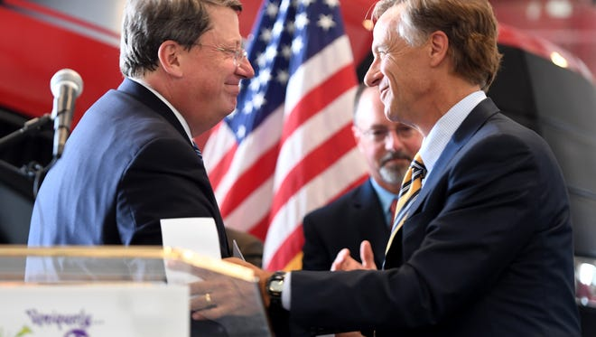 Tennessee Senate Majority Leader Mark Norris (R-Collierville) shakes hands with Governor Bill Haslam after introducing the governor, Tuesday, May 16. Governor Haslam signed the Tennessee Broadband Accessibility Act at H&R Agri-Power in Brownsville.