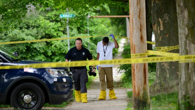 Lansing police investigate a death in the 700 block of Smith Avenue on Wednesday, May 24, 2017 in Lansing.