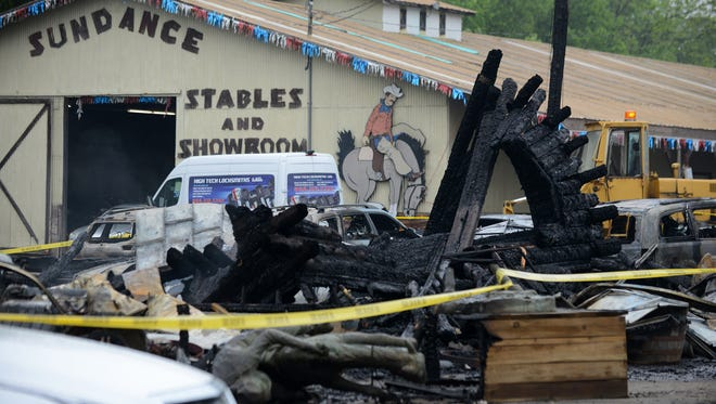 What remains of an office building at Sundance Chevrolet in Grand Ledge on Thursday, May 25, 2017 after an overnight fire. The fire destroyed an office building and some 30 vehicles at the dealership.