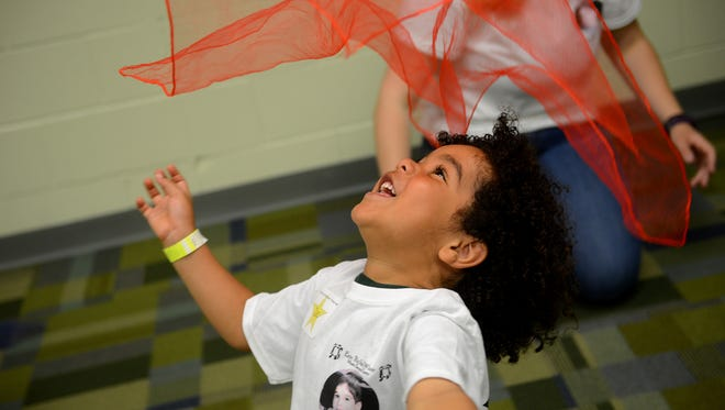 Zac Dunbar plays with a scarf during the RicStar's Music Camp on Monday, June 19, 2017 at the MSU Community Music School in East Lansing. The camp includes two three-day sessions, one for adults and one for children with special needs.