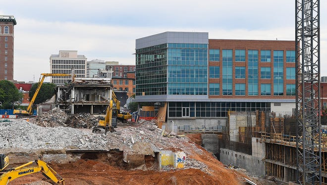 Final demolition of the former Greenville News complex at Main and Broad streets is under way this week. Staff have been working in the new Greenvile News tower, visible in this photo, for about six months.