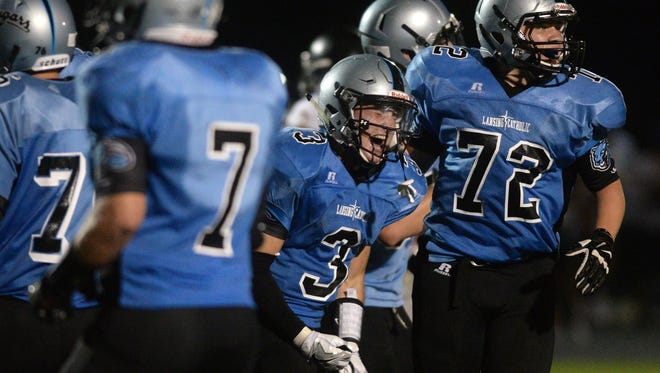Alex Bres (3) is one of four defensive starters returning for Lansing Catholic this fall.