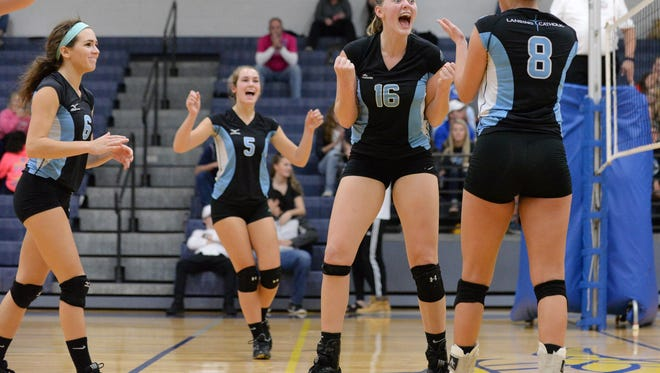 Lansing Catholic's Rebecka Poljan (16) is one of the Lansing area's top returning volleyball players.
