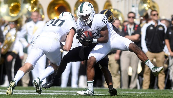 Michigan State's Josiah Scott intercepts a pass intended for a Western receiver during the first quarter on Saturday, Sept. 9, 2017, at Spartan Stadium in East Lansing.