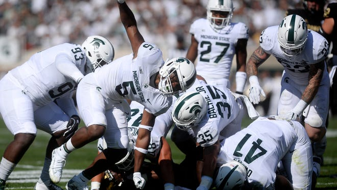 Michigan State's Andrew Dowell celebrates after he and his teammates tackled Western's Jamauri Bogan for a loss during the first quarter on Saturday, Sept. 9, 2017, at Spartan Stadium in East Lansing.