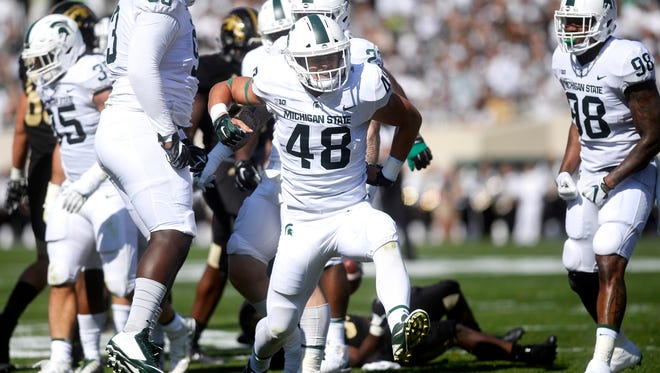 Michigan State's Kenny Willekes celebrates after he and his teammates tackled Western's Jamauri Bogan for a loss during the first quarter on Saturday, Sept. 9, 2017, at Spartan Stadium in East Lansing.