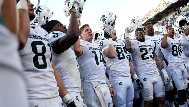 Michigan State Spartans celebrate after defeating Western Michigan 28-14 on Saturday, Sept. 9, 2017, at Spartan Stadium in East Lansing.