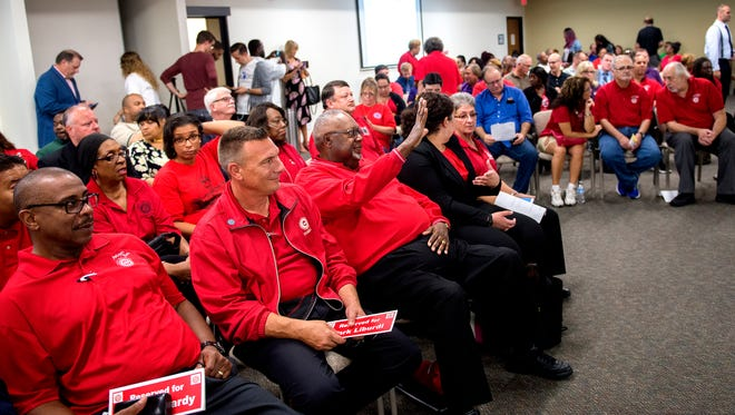 Union representatives fill the room before the start of a Michigan Civil Service Commission meeting on Wednesday, Sept. 20, 2017, at the Capitol Commons Center in Lansing. The commission voted on proposed rules changes that would limit collective bargaining for state employees.