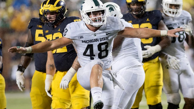 Michigan State's Kenny Willekes celebrates a tackle for a loss during the third quarter on Saturday, Oct. 7, 2017, at Michigan Stadium in Ann Arbor.