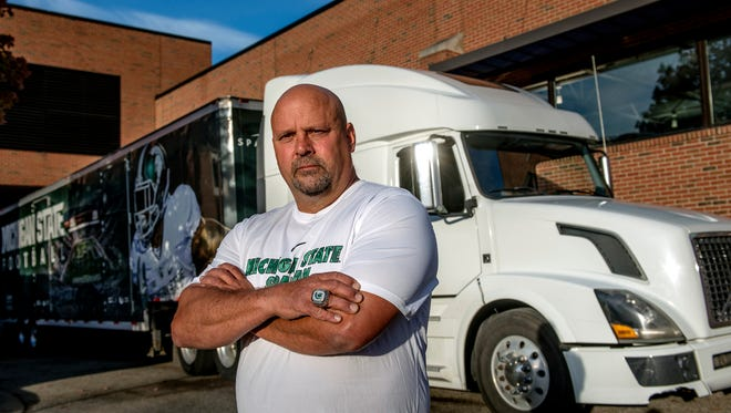 Glenn Edgett, photographed in front of a truck carrying the MSU football team equipment at the Duffy Daugherty Football Building on Thursday, Oct. 26, 2017, in East Lansing, has been delivering the Spartans football equipment to away games for nine years.