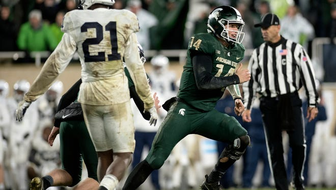 Michigan State quarterback Brian Lewerke celebrates after holding the ball for the game-winning field goal during the fourth quarter on Saturday, November 4, 2017, at Spartan Stadium in East Lansing.
