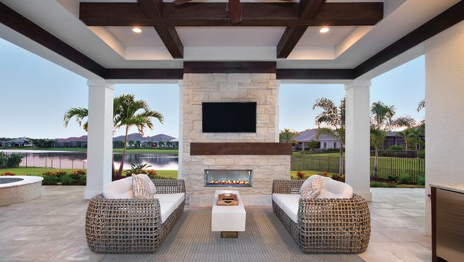 The Normandy II, with its impressive outdoor living area with pool, is one of five furnished models Stock Signature Homes has available in Quail West.