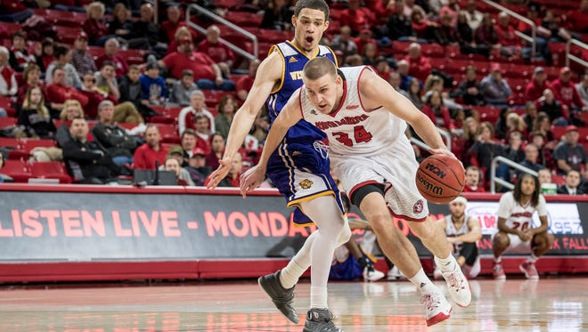 USD senior Nick Fuller drives past Western Illinois' Jeremiah Usiosefe on Wednesday night at the Sanford Coyote Sports Center.