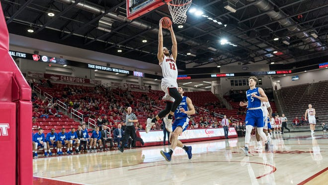 USD junior Trey Burch-Manning goes in for the dunk against Fort Wayne on Thursday night at the Sanford Coyote Sports Center.