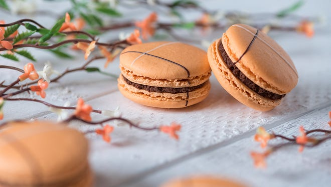 Chocolate orange macarons are a spring seasonal flavor at Macaron Bar, scheduled to open Aug. 1, 2018, on Mass Ave., Indianapolis.