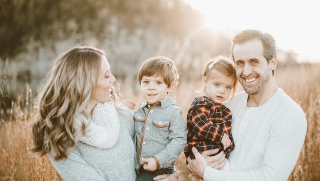Stephanie, left, and Jordan Schiding are pictured with their children Anthony and Genevieve. Both children were critically ill with E. coli linked to drinking raw milk, but are now recovering.