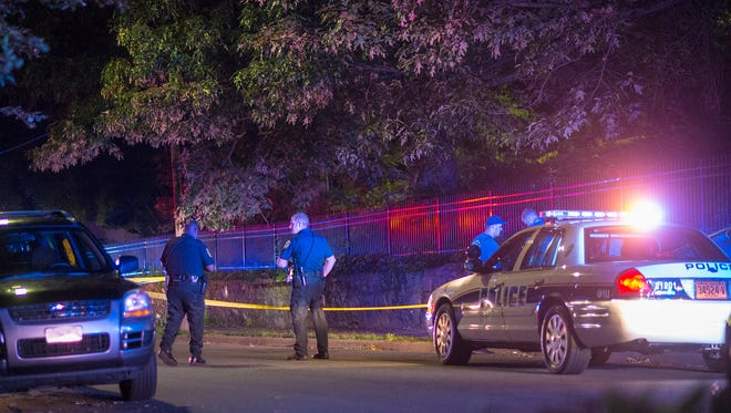 Police stand at the scene of a stabbing off of South French Broad Avenue Saturday night. The incident happened shortly after 11 p.m. near Aston Tower.