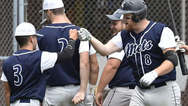 Maplewood's Chad Laluzerne (8) is congratulated after hitting a grand slam in the third inning against Kolberg during Door County League baseball on Sunday at Maplewood.