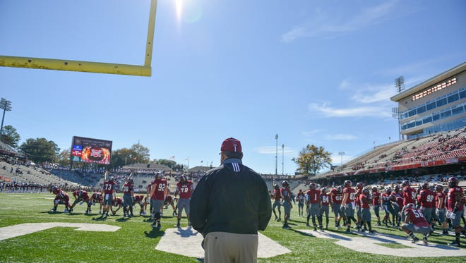Troy head coach, Larry Blakeney, soaks it all in prior to his final career game against Louisiana-Lafayette at Veterans Memorial Stadium in Troy, Ala. on Saturday, November 29, 2014.