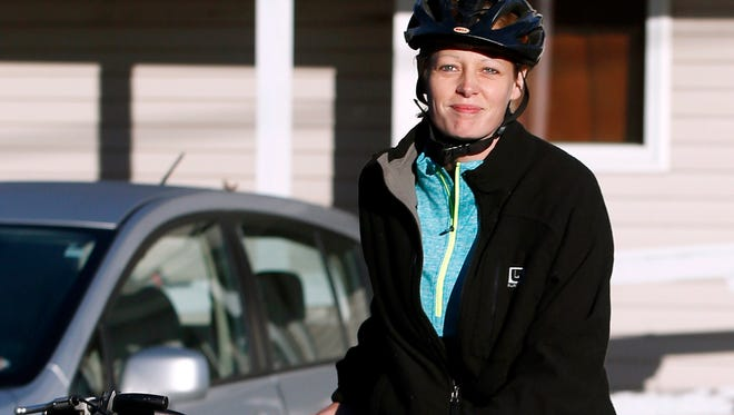 Nurse Kaci Hickox leaves her home on a rural road in Fort Kent, Maine, to take a bike ride with her boyfriend, Ted Wilbur, on Oct. 30.