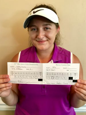 Sophia Canale of Fairlawn poses with her scorecard after recording a first-ever hole in one during the Ohio Junior Girls Championship Monday afternoon at the Marion Country Club.
