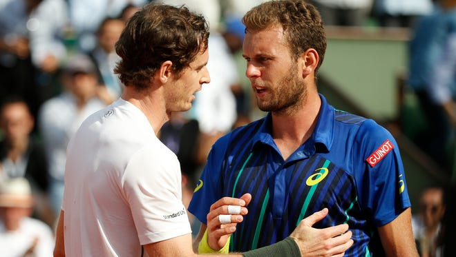 Britain's Andy Murray is congratulated by France's Mathias Bourgue after winning the  second-round match.