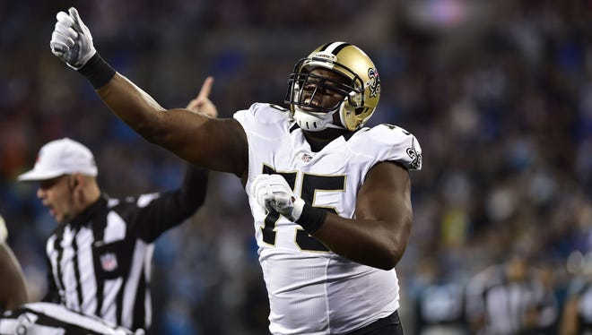 New Orleans Saints defensive end Tyrunn Walker reacts after the Saints recovered a fumble by Carolina Panthers quarterback Cam Newton.