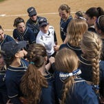 Essex coach Ashley Stebbins, center, talks to the team during the high school girls softball game between the Mount Abraham Eagles and the Essex Hornets at Essex high school on Thursday afternoon.