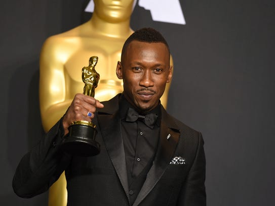 Mahershala Ali  with his award for best actor in a