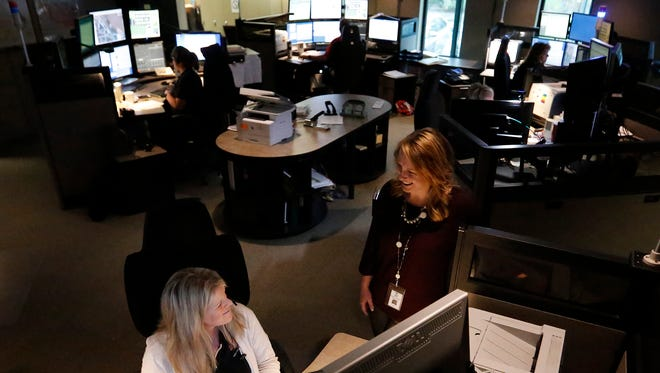 Director of Fond du Lac County Communications and Emergency Management Bobbi Hicken (right) talks with Fond du Lac dispatcher Angie Hoch Thursday May 10, 2018, at the Fond du Lac County 911 center. Fond du Lac and other communities in Northeast Wisconsin are preparing for Dark Sky - a mock disaster event scheduled May 15 -17. Doug Raflik/USA TODAY NETWORK-Wisconsin
