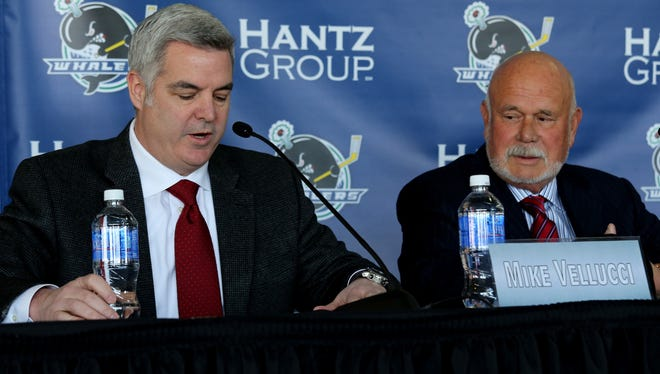 Mike Vellucci announces that Peter Karmanos Jr., right, owner of the Plymouth Whalers, has sold the team during a news conference at Compuware Arena  on Wednesday, Jan. 14, 2015.
