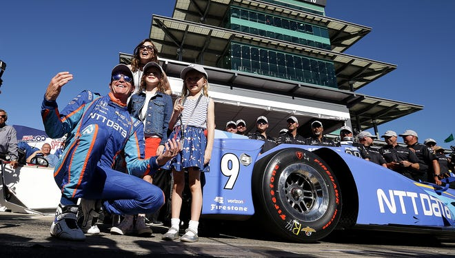 Chip Ganassi Racing IndyCar driver Scott Dixon (9) with wife Emma and daughter Poppy and Tilly,right, after wining the pole position for the Indianapolis 500 during Armed Forces Pole Day Sunday, May 21, 2017, afternoon at the Indianapolis Motor Speedway.