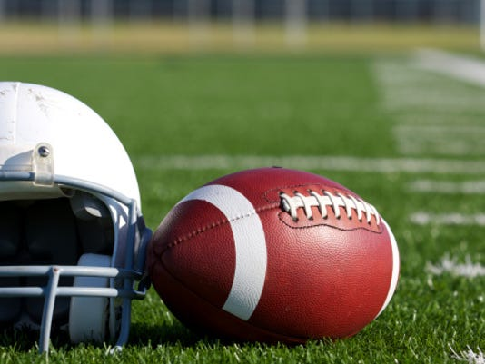 FOOTBALL AND HELMET ON FIELD