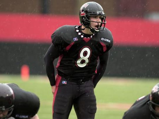 Gino Guidugli set multiple University of Cincinnati passing records during his career from 2001-04. After one year as running backs coach under Luke Fickell, he's in his second year coaching the quarterbacks. He holds many of the UC passing records.