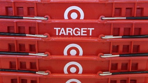 Shopping baskets are stacked at a Chicago area Target store in this file photo from 2013.